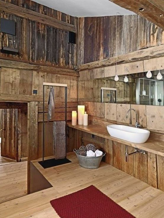 baños rústicos madera velas alfombras toallero