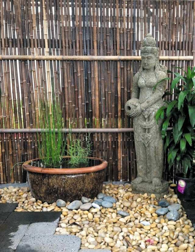 bambu estatua piedras cercado rocas