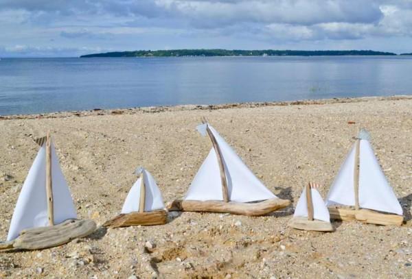 barquillos vela madera flotante playa