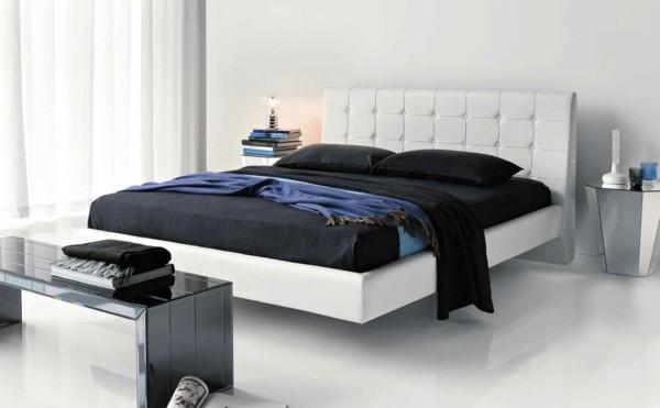cama blanca sábanas negras contraste