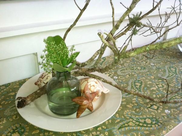 centro de mesa ramas flores