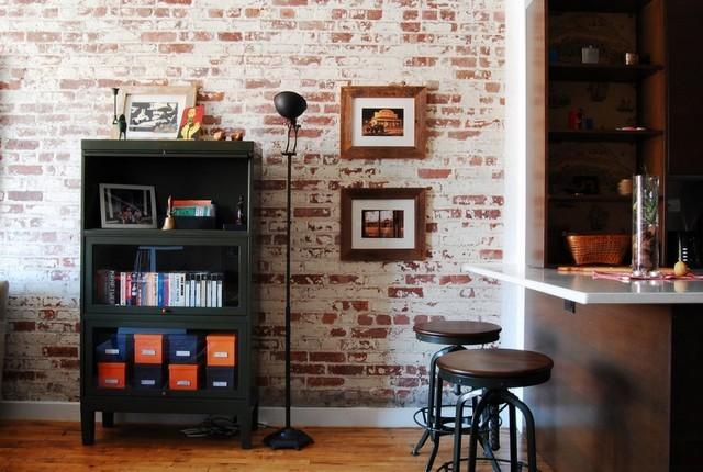 cocina pared ladrillo moderna mueble negro bonito