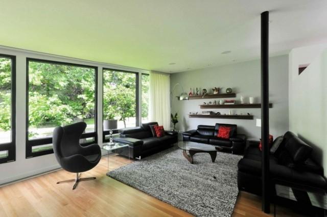 decoracion salon muebles cuero negro mesa cristal