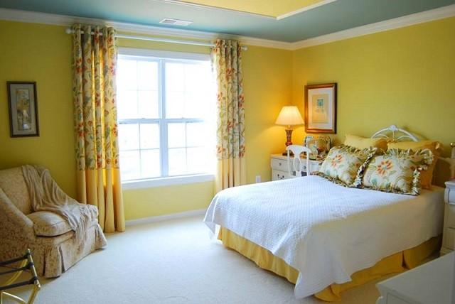 diseño de interiores con colores cálidos habitacion iluminacion cortinas