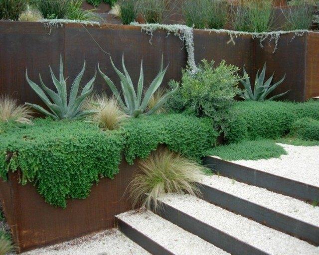 diseño de jardines muro metal plantas