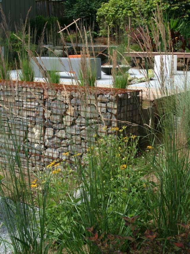 diseño de jardines piedras hoguera flores