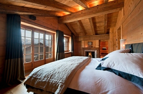 dormitorio rustico cama comodo ventanales vista