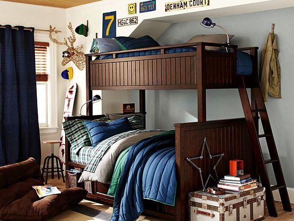 dos camas madera pequeño color marron