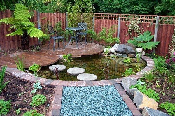 estanque  lago jardín isla piedras