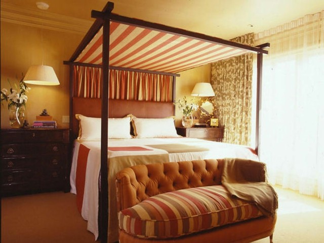 estilo mediteraneo naranja cama dosel tapada encima