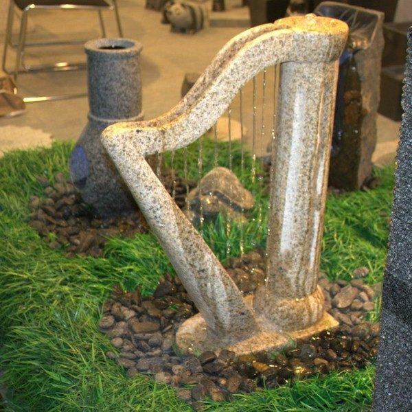 estupenda arpa fuente piedra decoración