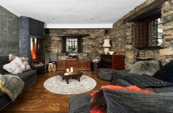 casa muebles diseño rustico muchas pieles pared piedra