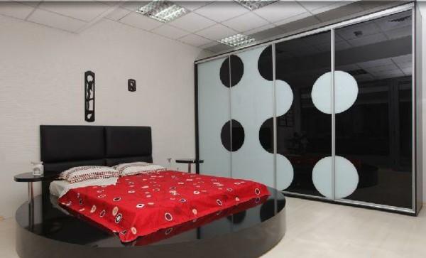 habitación moderna cama redonda negra