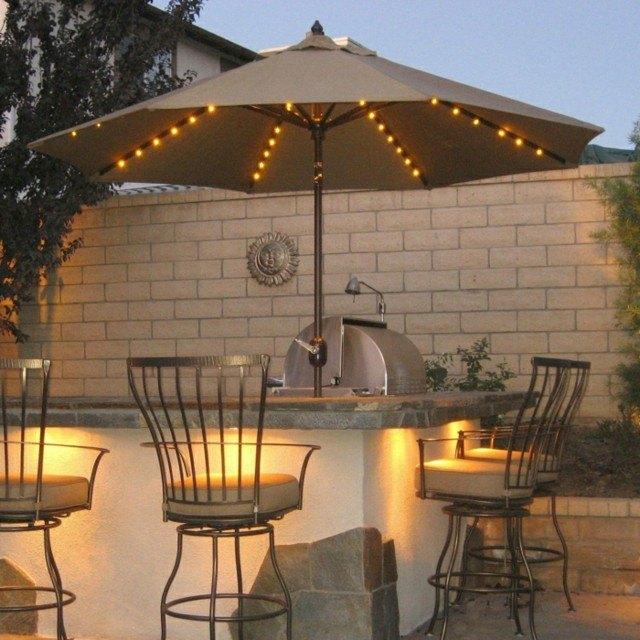 iluminación exterior sombrilla iluminada bar