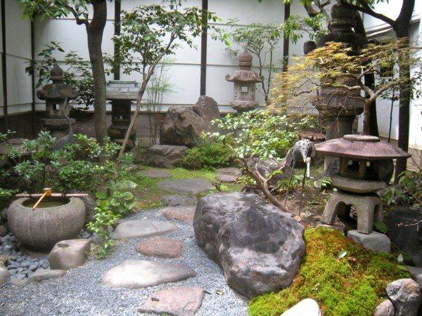 jardín oriental meditación fuente piedras