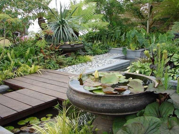 jardín japonés piedras casa puente madera