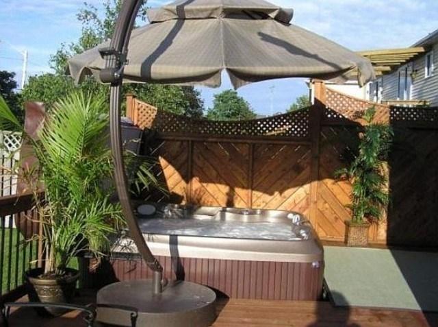 jardin trasero jacuzzi proteccion sol