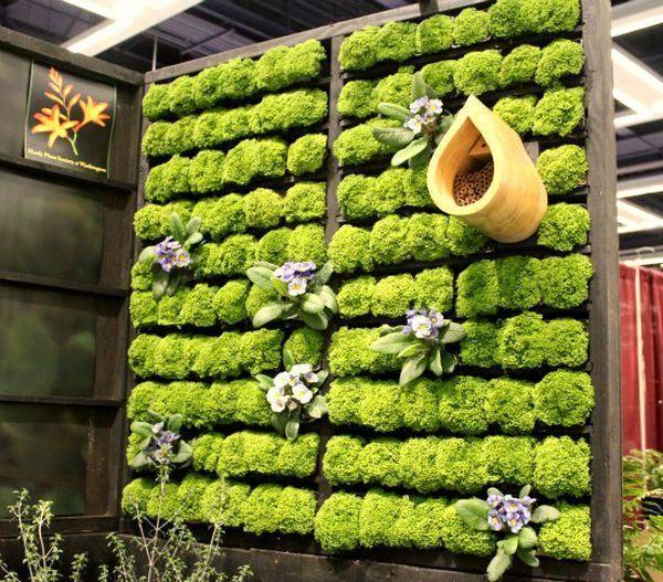 jardines verticales interior flores madera