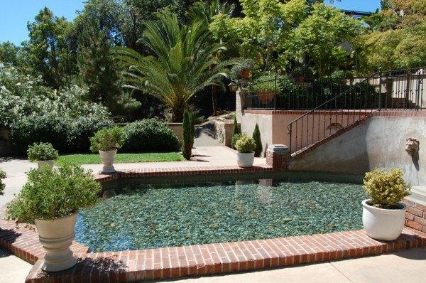Lagos y piscinas naturales para el jard n - Piedras para piscinas ...