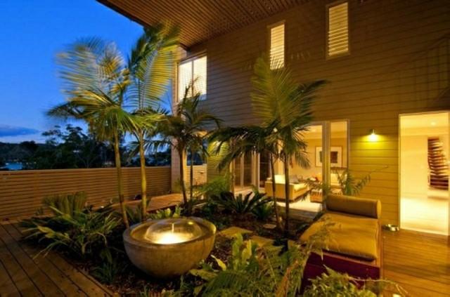 Iluminaci n exterior que har brillar a tu jard n - Fuentes solares para jardin ...