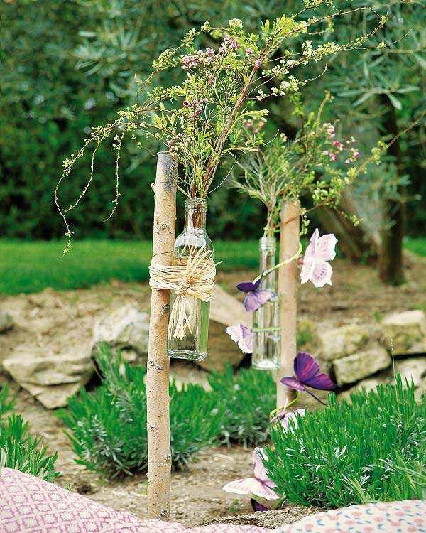 manualidades originales botellas florero jardin