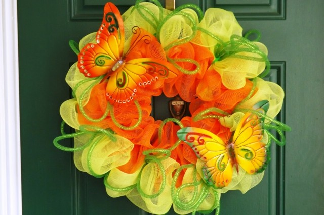 mariposas naranja verde combinacion mano puerta