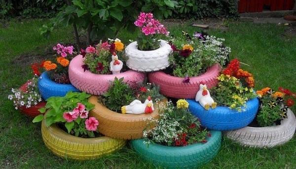 neumáticos colores maceteros jardín flores
