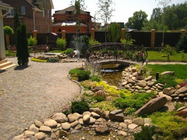 paisajismo puente estanque jardin piedra