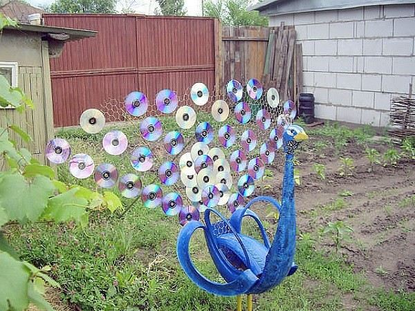 pavorreal neumaticos jardin discos decoracion
