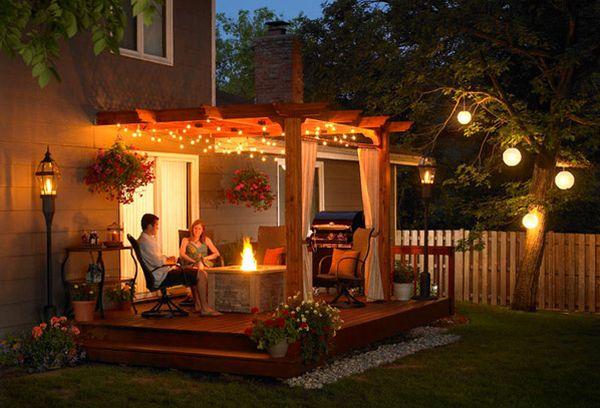 pérgola plataforma muebles madera lamparas