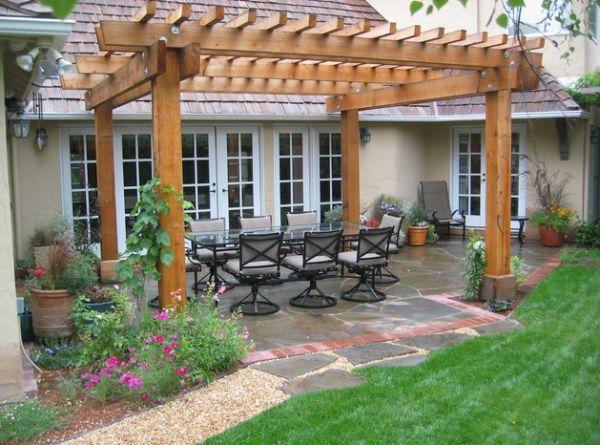 pérgolas de madera macetas flores jardin comedor exterior