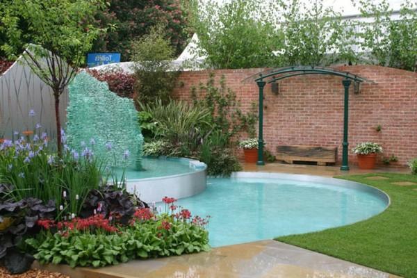 piscina lagos jardín cascada flores