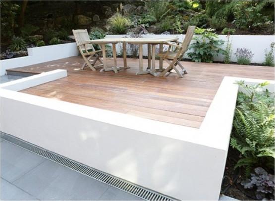 plataforma jardin sillas mesa rustica helechos