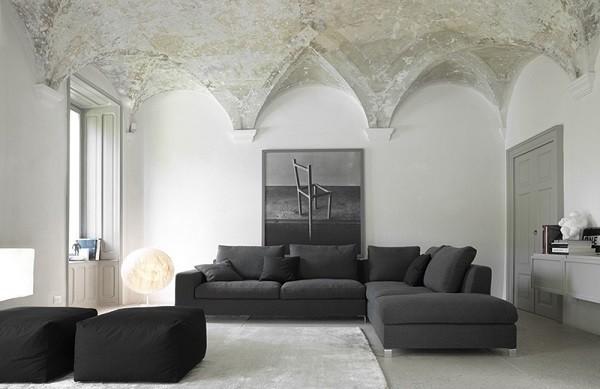 salón moderno cúpulas sofá negro