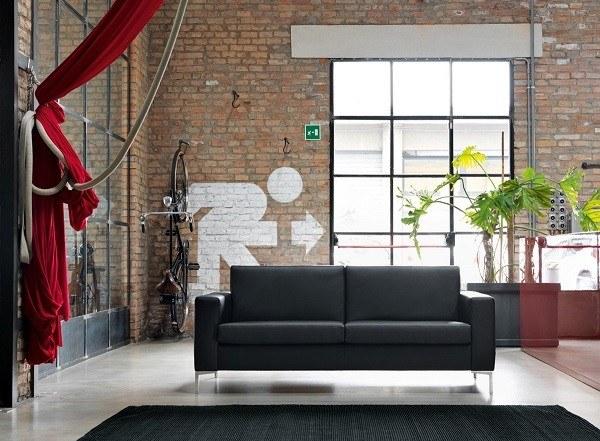 salón moderno sofá negro exit