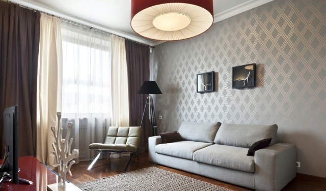 salon gris butaca comodo cuero pared diseño interesante