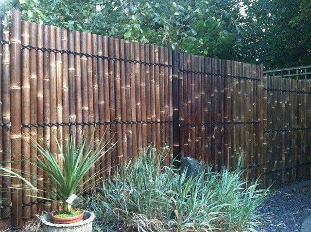 vallas de madera patio jardin macetas plantas