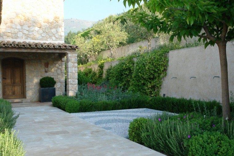 James Basson jardin delante casa camino plantas piedras ideas