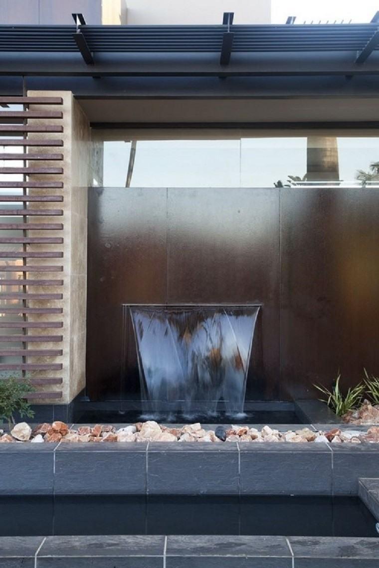 agua estanque rocas muro moderno casacada