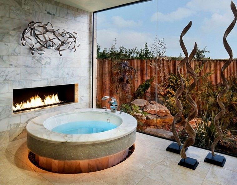 bañera redonda chimenea patio vistas