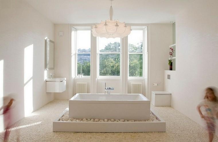 bañera blanca rectangular piedras zen
