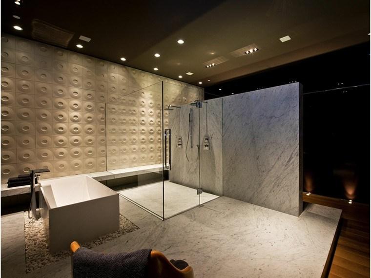 baño moderno pared circulos mármol
