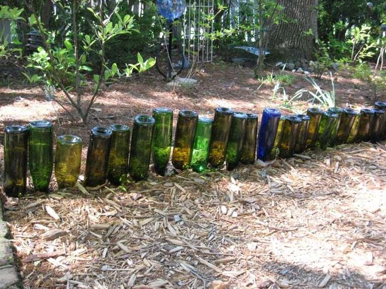borde valla botellas cristal verdes