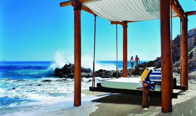 cama colgante madera playa vistas