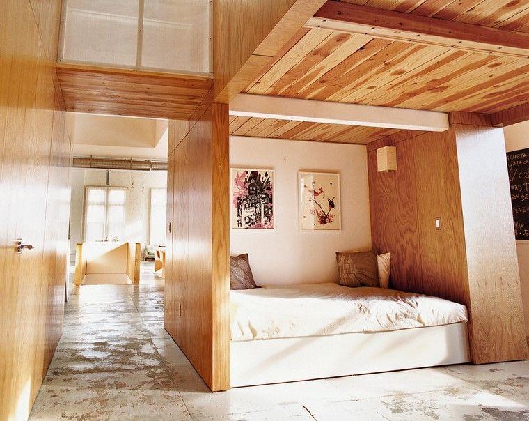 cama habitacion madera luces cuadros