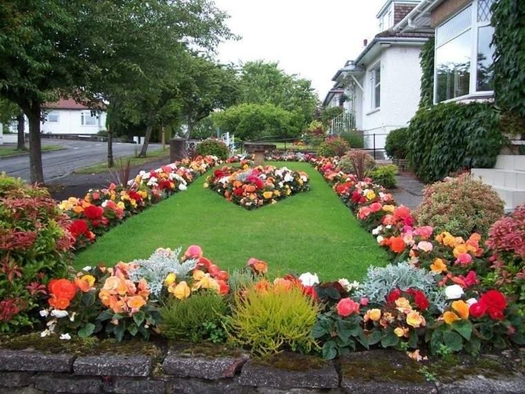 como diseñar un jardin muro rocas exterior flores