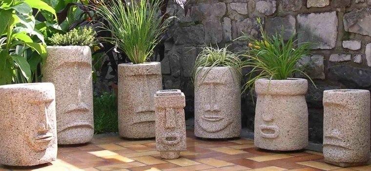 decoración con maceteros creativos caras esculturas