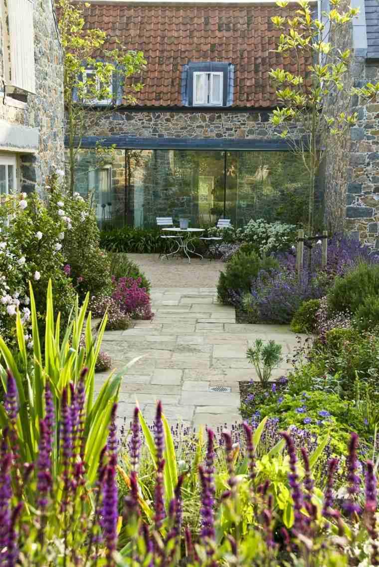 diseno-de-jardines modernos Debbie Roberts camino piedra rodeado flores ideas