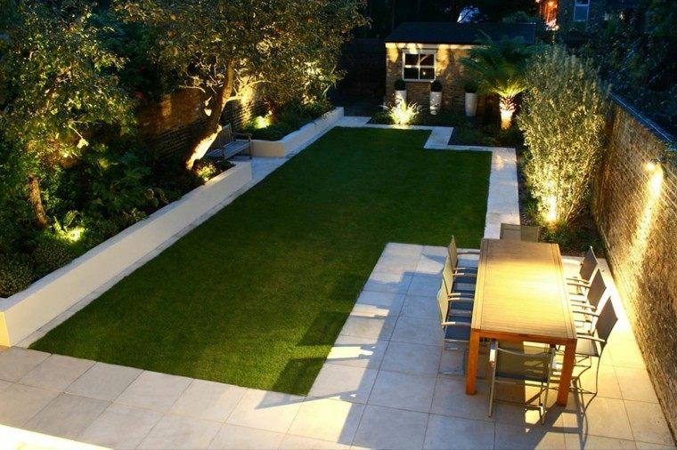 diseño de jardines modernos iluminados noche lugar cenas cesped ideas