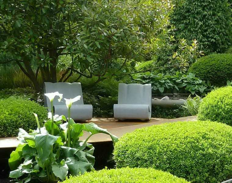 diseño de jardines modernos vegetacion densa muebles interesantes ideas